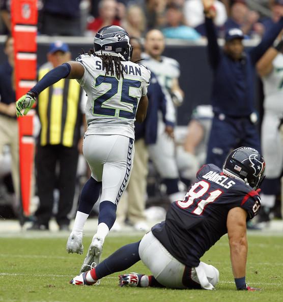 O momento em que Richard Sherman dos Seattle Seahawks interecpta a bola e muda o curso do jogo Foto de Bob Levey/Getty Images